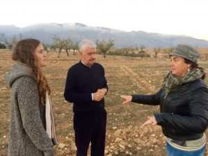 The owner of the terrain explains the areas historical importance in organic almond production.